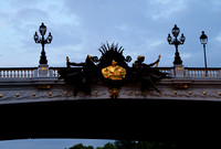 Nymphs on Pont Alexandre III, bearing the seal of Paris