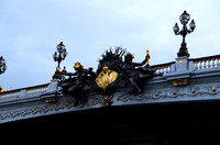 Nymphs on Pont Alexandre III, bearing the seal of Russia